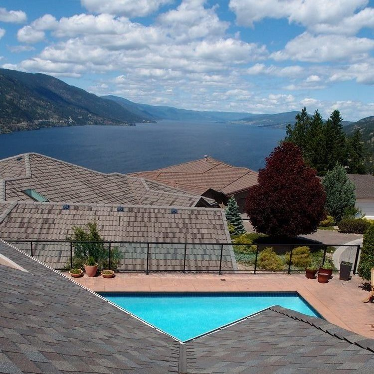 rooftop views of Lake Okanagan with swimming pool below