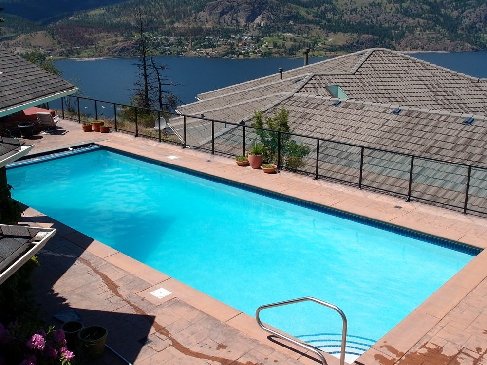 – inviting blue waters of a swimming pool provide a refreshing escape from the heat of the Okanagan summer.