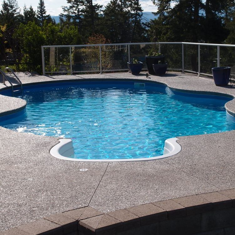 wavy contoured pool sides make an interesting feature to this swimming pool as the sunlight shimmers on the surface, a very inviting place to escape the searing heat of the Okanagan summer.