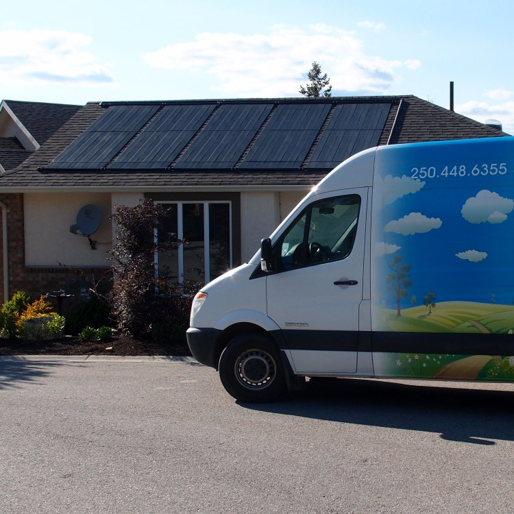 white van in front of rancher style home with solar situated on the roof.